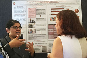 Nancy Pandhi, MD, MPH, PhD, discusses her team's research at NAPCRG's poster walk.