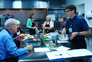 DFMCH resident Jared Dubey, DO, (on right) also helps lead the Prairie Kitchen Cooking Club.
