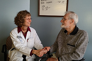 Dr. Hamrick and Lynn Phelps, MD. Now a Capitol Lakes resident, Dr. Phelps is a family physician who created the DFMCH's original Wingra Clinic. (Photo: Capitol Lakes, Inc.)