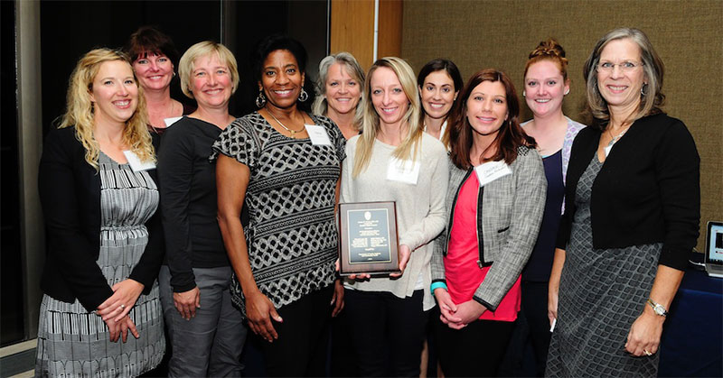 Above, the Davis Award-winning team. From left: Erin MacMillan, RN; Rhonda Lang, RN; Lisa Simpson, PA-C; Trina Copus, Clinic Manager; Linda Kiefer, RN, Nurse Manager; Elizabeth Paape, RN; Jackie Gerhart, MD; Candice Rockwell, RN; Brianna Matheson, MA; Kathy Seymer, RN, MSHI, Director of Primary Care Operations